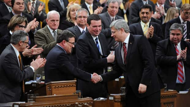 Minister of Finance Jim Flaherty shakes hands with Prime Minister Stephen Harper after delivering the Budget in the House of Commons on Parliament Hill in Ottawa on March 29. Flaherty's budget has $1.6 billion in spending on innovation.