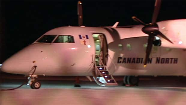 A Canadian North Dash 8 aircraft, like this one seen in Yellowknife, was broken into in Pond Inlet, Nunavut, the night of April 4. The airline says it will no longer leave its planes overnight in the community until airport security improves.