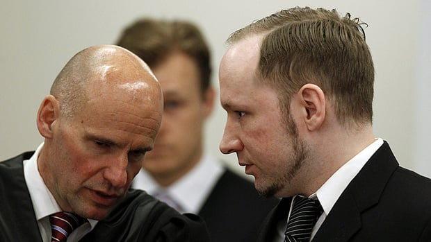 Norwegian mass killer Anders Behring Breivik (right) listens to his defence lawyer Geir Lippestad before the start of the fourth day of his terrorism and murder trial in Oslo on April 19.