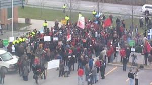 Hundreds of people gathered outside a Gatineau high school Sunday to protest the Quebec government's plan to raise tuition fees. Premier Jean Charest was visiting the school.