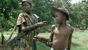 Charles Taylor is the highest-ranking leader ever brought to court accused of recruiting child soldiers, like these two seen in 2000 during the conflict in Sierra Leone.