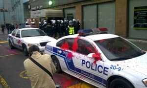 A police car is spattered with paint during Tuesday night's May Day riot in downtown Montreal.