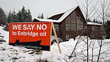 A sign showing opposition to the $5.5-billion Enbridge oil pipeline from Alberta to the northwest coast of British Columbia sits on a property in Kitimat, B.C., on Jan. 12, 2012.