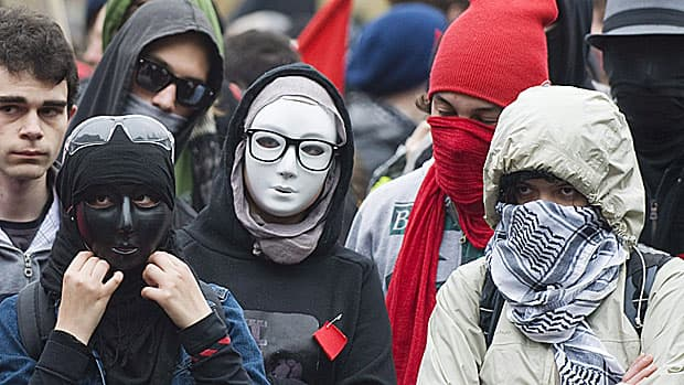 Masked protesters take part in an anti-capitalist demonstration in Montreal, Tuesday, May 1, 2012. A bill to make it illegal to wear a mask during a violent demonstration is nearing its final hurdle in the House of Commons, with just two hours of debate left.