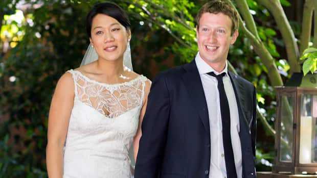 Facebook founder and CEO Mark Zuckerberg and Priscilla Chan are seen at their wedding ceremony in Palo Alto, Calif., on Saturday.