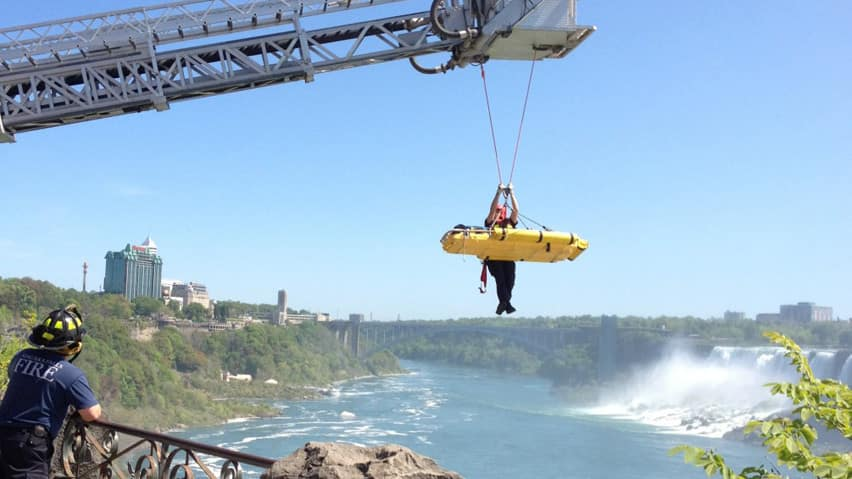 A man was rescued after falling into the water below Niagara Falls on Victoria Day as visitors looked on.