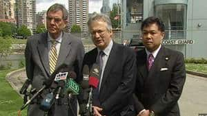 Coun. Geoff Meggs, centre, was joined by Coun. Tim Stevenson and Coun. Kerry Jang at the Kitsilano coast guard station on Tuesday.