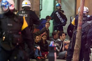 Montreal police arrest protesters during Tuesday's demonstration against the tuition fee hike.