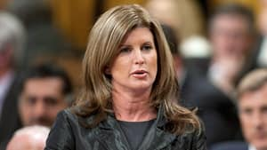 Public Works Minister Rona Ambrose, seen here in the House of Commons last week, told defence contractors at a military trade show Wednesday that she's tired of duplication and competing agendas within government when it comes to military purchases.