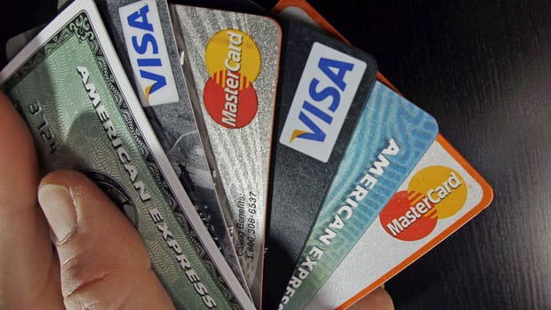 The average Canadian's non-mortgage debt hit a 8-year high in the second quarter, TransUnion says.