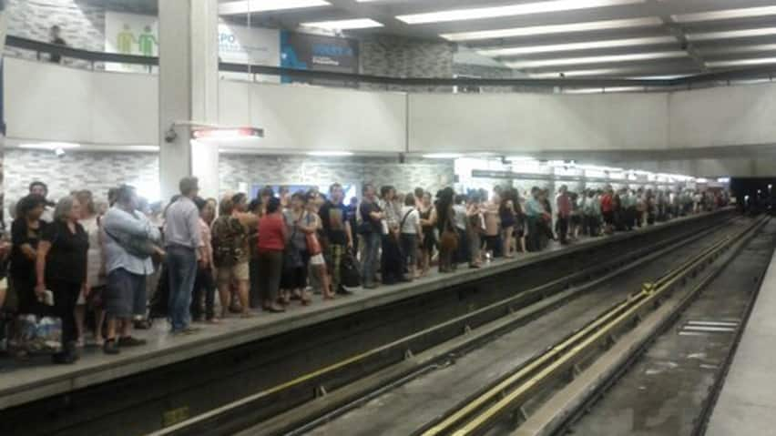 Hundreds of people crowd the platform at the Place des Arts metro station.