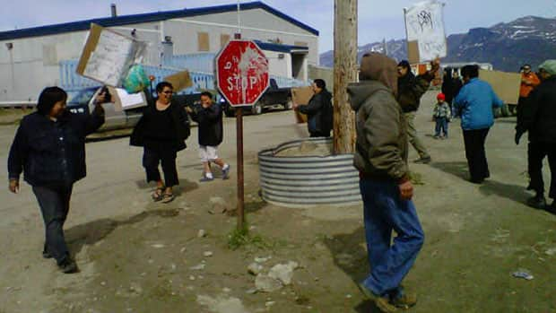 Residents of Pangnirtung, Nunavut, protest the high price of food in their community on June 21, 2012.