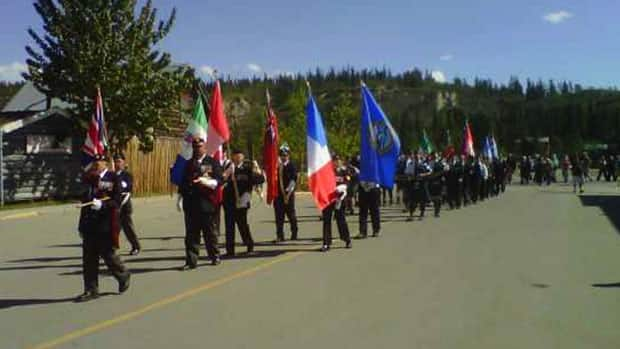 On Friday, delegates from a French group that cares for Canadian war graves participated in a short parade through downtown Whitehorse to city hall. There, flags were raised and wreaths laid at the war memorial.