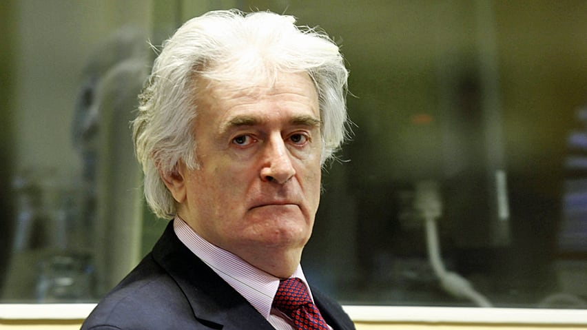 Former Bosnian Serb leader Radovan Karadzic has been acquited by the UN's Yugoslav war crimes tribunal of one of the two genocide charges he faces at the halfway stage of his long-running trial.
