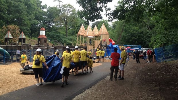 Volunteers work on Saturday to rebuild the playground in High Park.