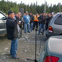 Electrician Kevin Slaney addresses workers gathered near the road to Long Harbour on Monday morning.