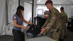 A soldier heads a security check at the main entrance adjacent to Westfield Stratford City Mall at the Olympic Park on Tuesday in London with the Games opening just 10 days away.