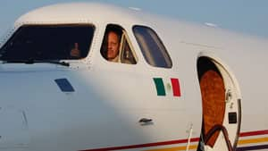 Bodyguard Gary Peters aboard an aircraft: not a national security risk, he says. Submitted