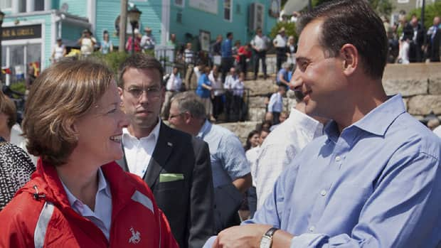 P.E.I. Premier Robert Ghiz chats with Alberta Premier Alison Redford during an event at the premiers conference in Lunenburg, N.S.