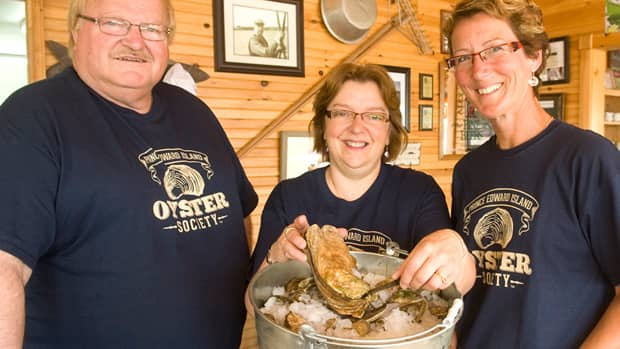 Fisheries minister Ron MacKinley joins Phyllis Carr (centre) of Carr's Oyster Bar and Ann Worth, executive director of the P.E.I. Aquaculture Alliance, for the launch of the new campaign.