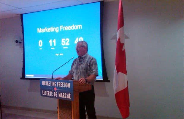 Federal Agriculture Minister Gerry Ritz in front of the countdown clock to marketing freedom for western grain and barley farmers.