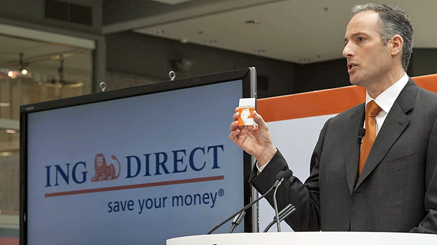 ING Direct CEO Peter Aceto holds one of the company's debit cards at the service's launch in 2010. The company's Dutch parent is reportedly considering selling the Canadian unit.