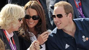 Camilla Parker Bowles, Duchess of Cornwall, left, Kate Middleton, Duchess of Cambridge, and Prince William chat while they wait for Britain's hopeful Zara Phillips to compete in an equestrian event at the London Olympics on July 30.