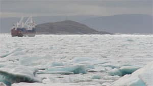 A sealift ship is anchored amid ice in Frobisher Bay off Iqaluit earlier this summer when ice was delaying unloading of cargo from the ships.