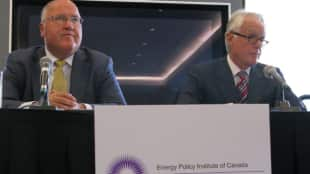 Gerry Protti, left, and Doug Black from the Energy Policy Institute of Canada speak at a news conference in Calgary. The group has unveiled a framework for a national energy strategy.