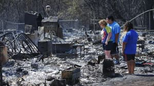 Luther, Okla., residents sifted through their charred belongings Saturday to salvage what they could after fires destroyed many homes.