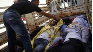 A Syrian man checks one of nine bodies of Syrians found dead outside the town of Anadan outskirts of Aleppo on Monday.