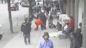 A surveillance video shows Const. Taylor Robinson allegedly shoving Sandy Davidsen on a Hastings Street sidewalk in June 2010.