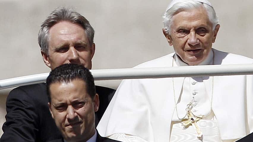 The Pope's butler, Paolo Gabriele (bottom left), seen with Pope Benedict (right) in St. Peter's Square in May 2012, is to stand trial for theft.