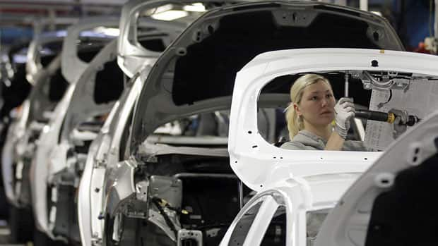Workers build Ford Fiestas at a factory in Cologne in February. The eurozone would would have slipped into recession in the spring had it not been for better-than-expected GDP growth in Germany and France.