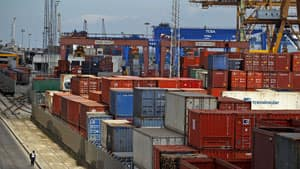 The port of Lisbon lies idle, closed by a dock workers' strike against austerity measures Tuesday. Portugal suffered a big 1.2 per cent drop in output in the spring.