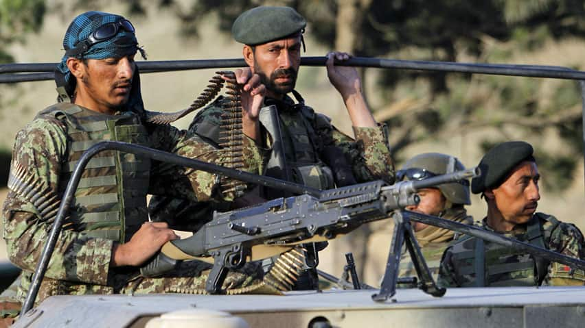 Afghan National Army soldiers are photographed while on duty in Kabul in this June file photo. There has been a disturbing rise of incidents in which gunmen dressed in Afghan army uniforms have turned on NATO coalition troops.