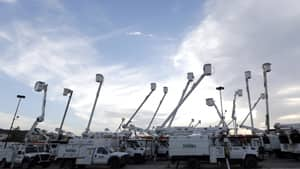 Utility trucks stage outside New Orleans as recovery efforts after Hurricane Isaac continue in New Orleans on Friday.