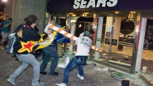 Rioters break the front doors of a Sears department store on Granville Street during the 2011 Stanley Cup riot in downtown Vancouver.