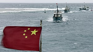 Chinese boats sail in the lagoon of Meiji reef off the island of Hainan, which is also claimed by Vietnam
