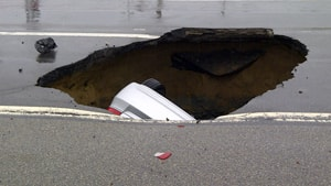 This sinkhole swallowed Juan Pedro Unger's four-door sedan as he drove home during rush hour Tuesday in east Ottawa.