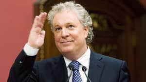 Quebec Premier Jean Charest waves to applauding people after being sworn in on Dec. 18, 2008, at the Quebec legislature.