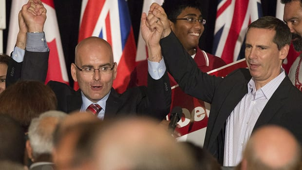 Ontario Liberal candidate Steven Del Duca and Premier Dalton McGuinty, right, celebrate Thursday's Liberal byelection win in Vaughan. The Liberals failed to win the Kitchener-Waterloo riding, ending hopes of a Liberal majority government.