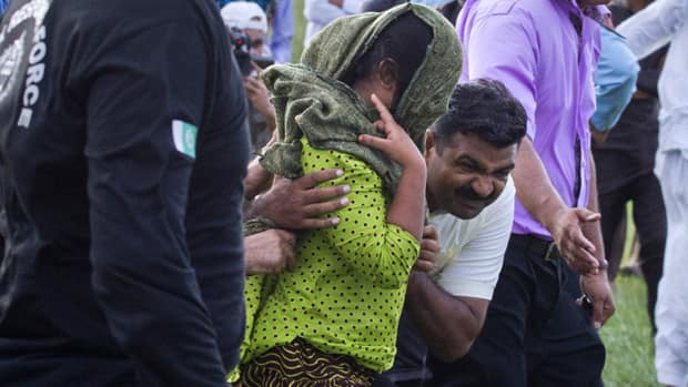 Security officials surrounding a Christian girl accused of blasphemy and move her to a helicopter after her release from Adyala jail in Rawalpindi, Pakistan on Saturday.