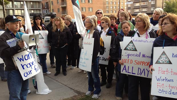 Support workers march outside the Edmonton Catholic School Board office Monday morning, calling for higher wages and better job security.