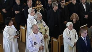 Roman Catholic priest Joseph Dubé, centre, presided over the funeral, saying 'Denis now lives in the kingdom of God.'