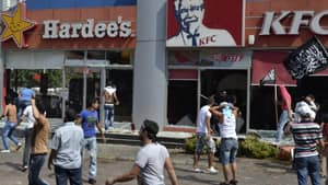 Protesters angry over the film ridiculing the Prophet Muhammad attacked American fast food restaurants after Friday prayers in the northeastern city of Tripoli, Lebanon.