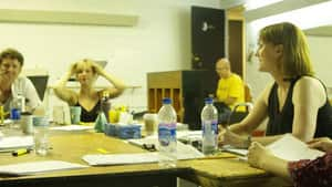 Diane Barnes sits with actors at a table for a read through of the new musical Sadie Calhoun at the Confederation Centre in August.