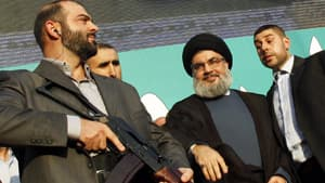 Lebanon's Hezbollah leader Sayyed Hassan Nasrallah (second from right), escorted by his bodyguards, greets his supporters at an anti-U.S. protest in Beirut's southern suburbs when he made a rare public appearance on Monday.