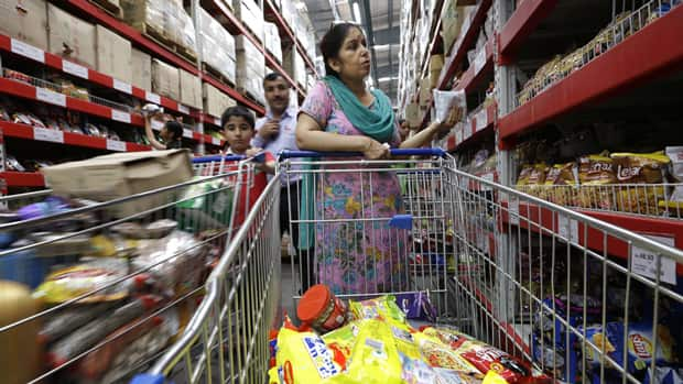 People shop at a Bharti-Walmart wholesale store on the outskirts of Chandigarh, India. India agreed Friday to open its huge market to foreign retailers as part of a flurry of economic reforms aimed at sparking new growth in the country's sputtering economy.