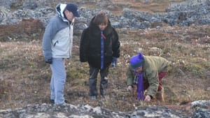 Prince Albert of Monaco and Okalik Eegeesiak, president of the Qikiqtani Inuit Association, listen to elder Alicee Joamie as she talks about the tundra near Iqaluit.